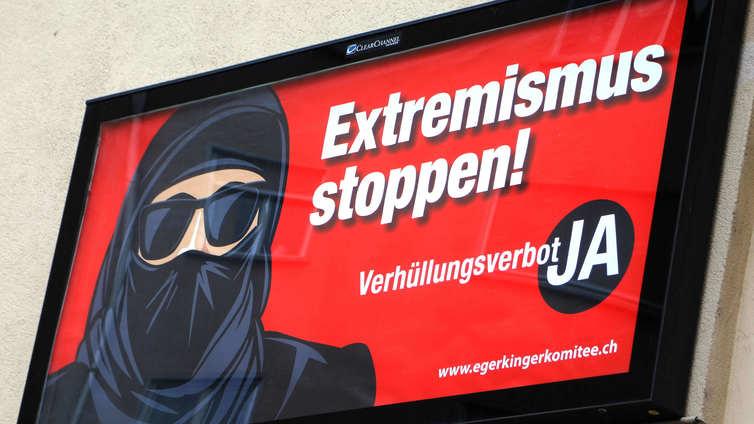 Kasvojen peittäminen julkisilla paikoilla kielletään Sveitsissä